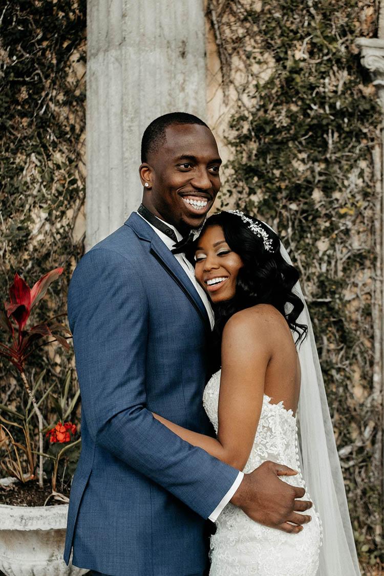 Glamorous Wedding Couple Hugging & Smiling | photo by The Portos