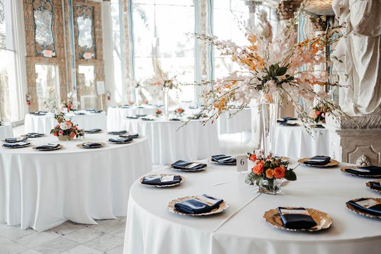 White, Gold, & Navy Wedding Reception Decor | photo by The Portos