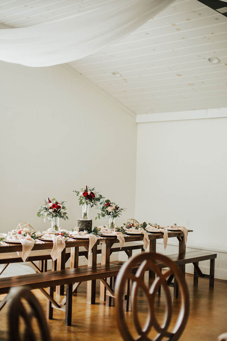 Farm Table Wedding Reception with Pink Tied Napkins & Red Roses | photo by Jessica Lee Photographic Art