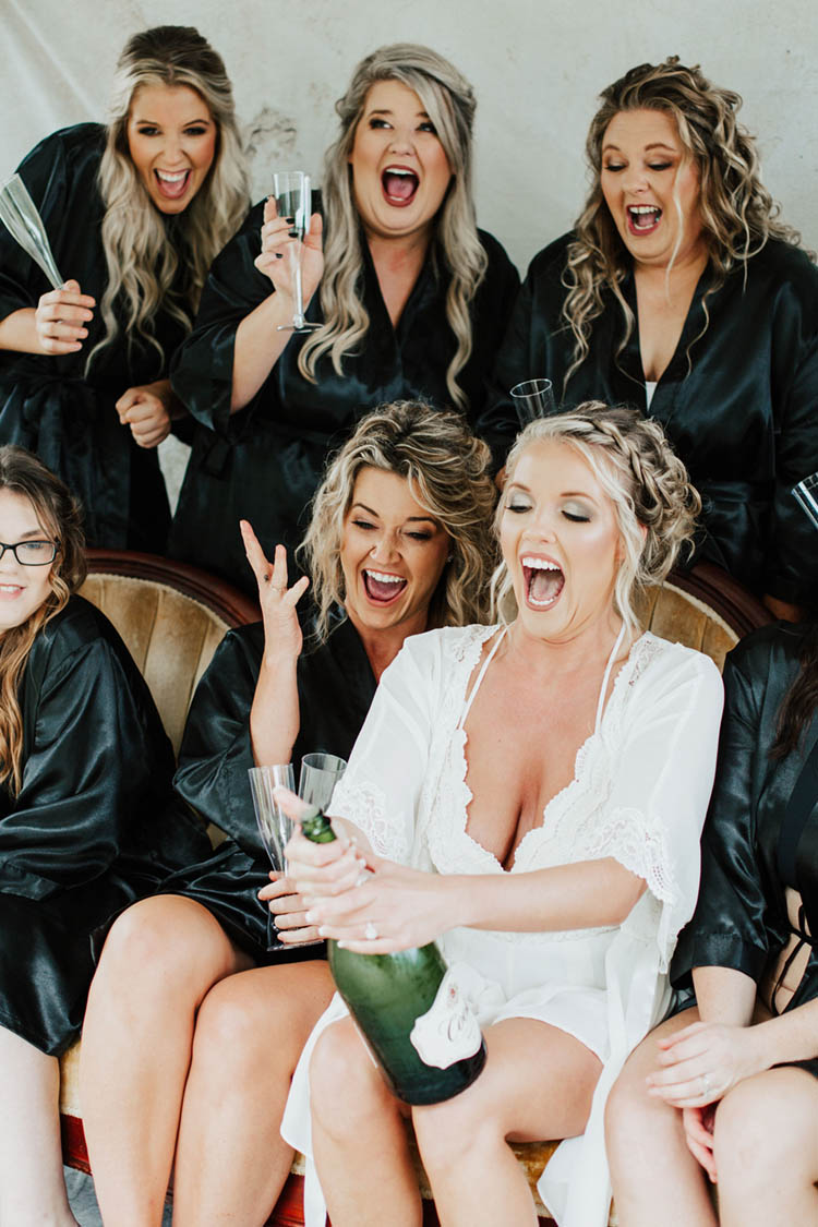 Bride Champagne Pop with Bridesmaids in Robes | photo by Jessica Lee Photographic Art