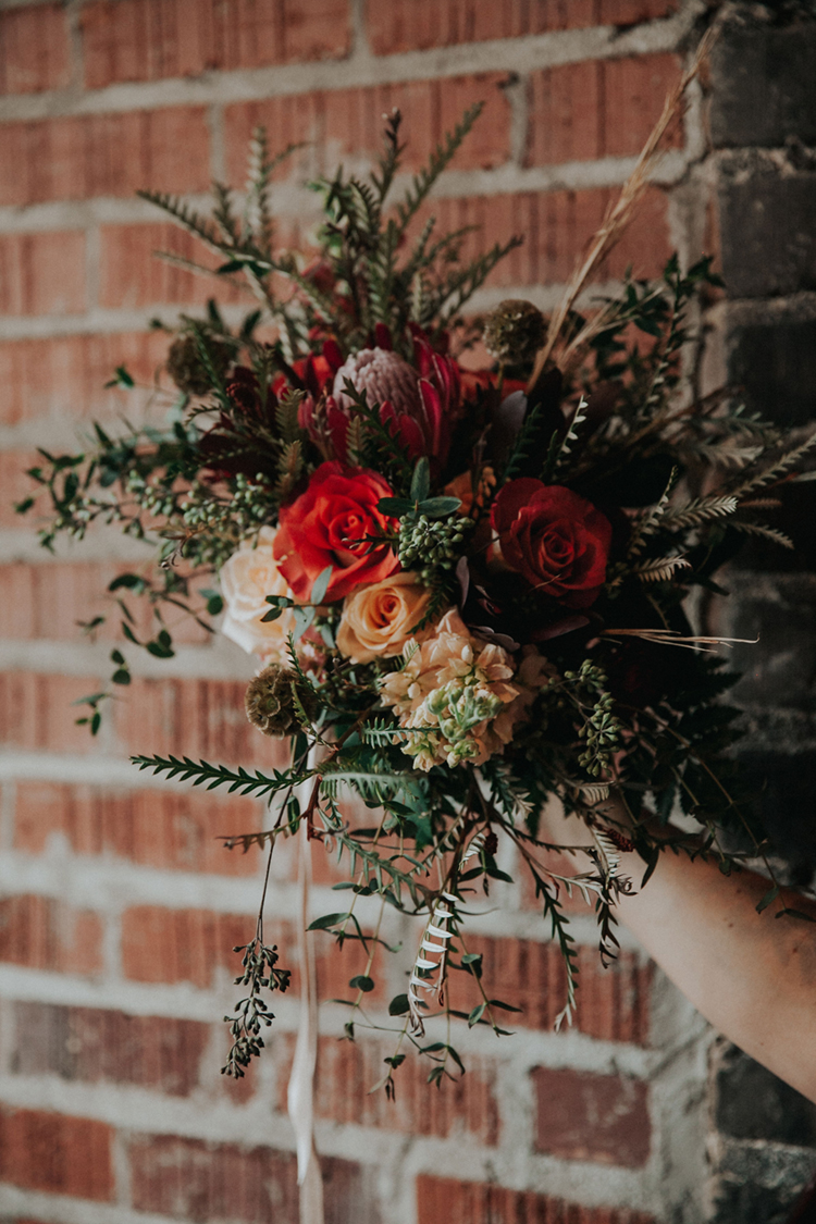 Lush Boho Wedding Bouquet with King Protea and Roses | photo by Deltalow