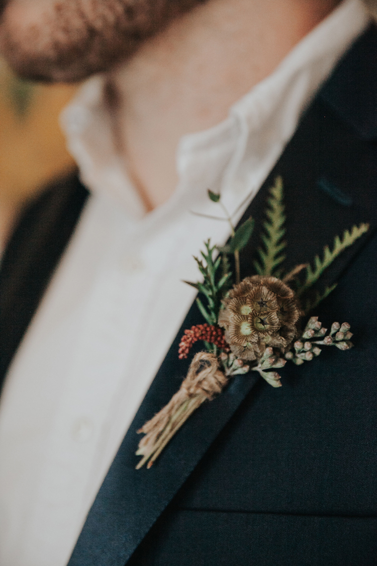 Moody Boho Groom Boutonniere | photo by Deltalow