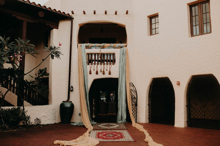 Moroccan Inspired Wedding Ceremony with Elaborate Draping and Rugs | photo by Boote Photography Studio