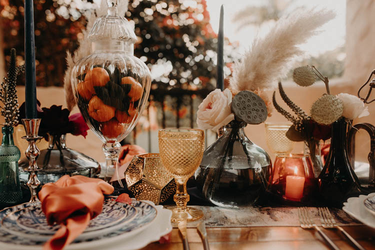 Bohemian Wedding Table Decor with Oranges and Antique Colored Glassware | photo by Boote Photography Studio