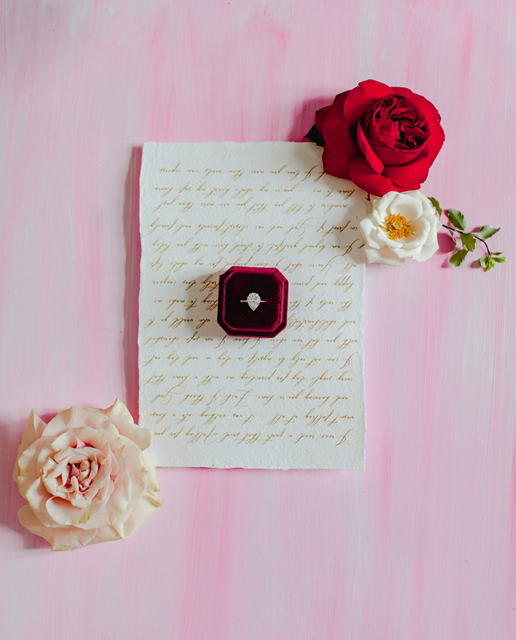 Velvet Ring Box with Pear Shaped Engagement Ring on Love Note | photo by Gricelda's Photography